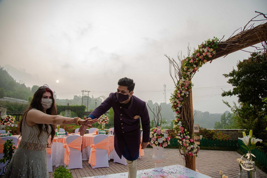 Goofy Pictures of Aparna & Arnav from their Destination Engagement Party with beautiful sunset backdrop